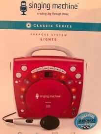 Singing machine karaoke system with lights