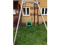 TP Forest wooden single swing with additional quadpod baby seat.