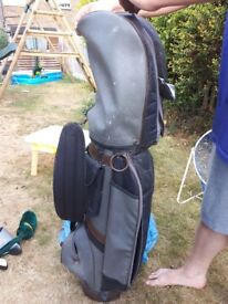 Golf clubs and black and grey bag