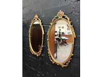 Beautiful pair of metal framed vintage mirrors in pristine condition .
