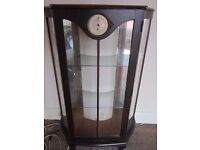 bargain display cabinet with clock. FREE DELIVERY