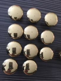 15 Brass cabinet knobs. (Used) 11 unmarked, 1 with light scratches and 3 that might be polished
