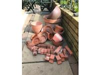 Selection of terracotta pots and pot feet