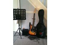 ARIA STG-Series Electric Guitar, TGI Carry Case, AMP, Music Stand, Guitar Stand and digital Tuner