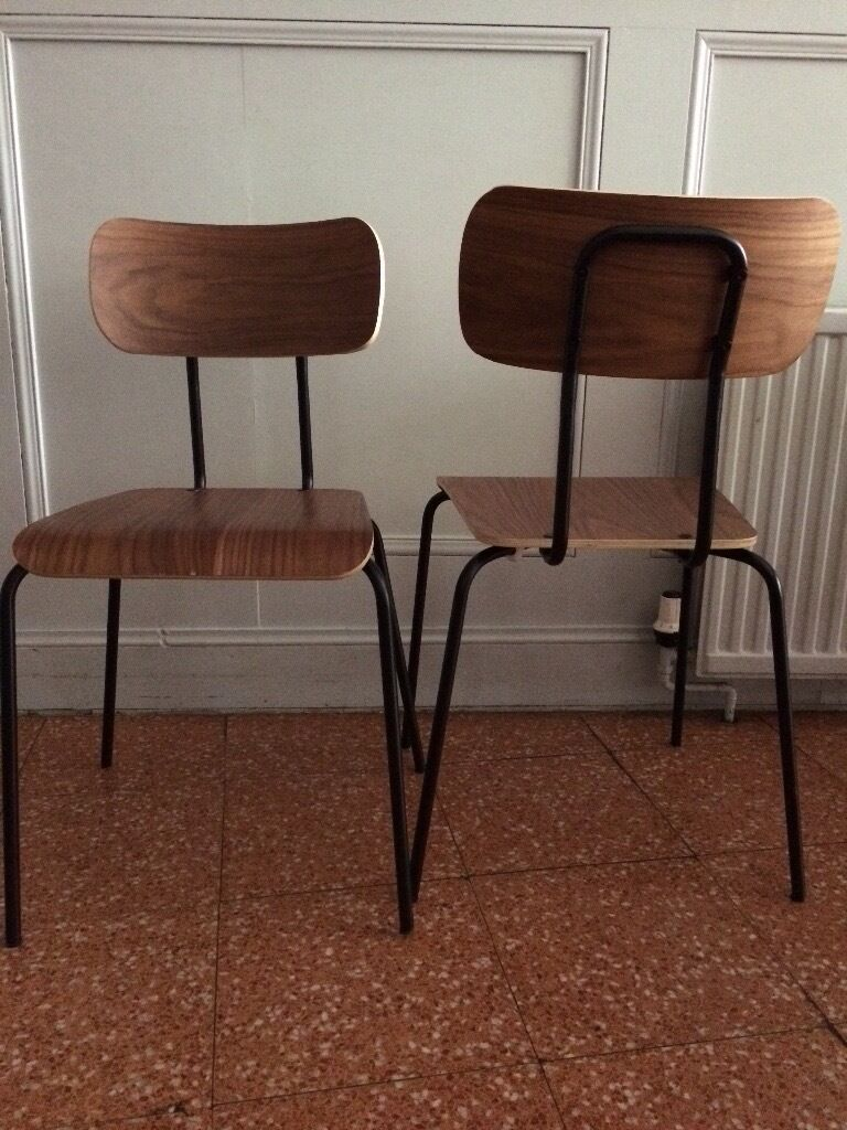 Dining chairs, walnutin New Town, EdinburghGumtree - Dining chairs Clear lacquer finish Walnut Veneer, Black Metal legs & frame Bought from made. com A little worn, but good condition 7 available £20 each Collection only