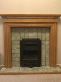 Pine fireplace surround and iron gas fire