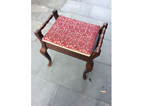 Piano stool with storage , in good condition . Great shaped legs , seat lifts up for storage.