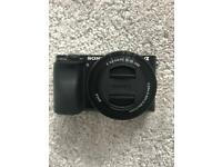 Sony A6000 camera with 16-50mm OSS lens, HD 1080p, 24.3MP, WIFI