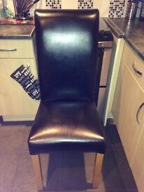 4 next black faux real leather roll back chairs