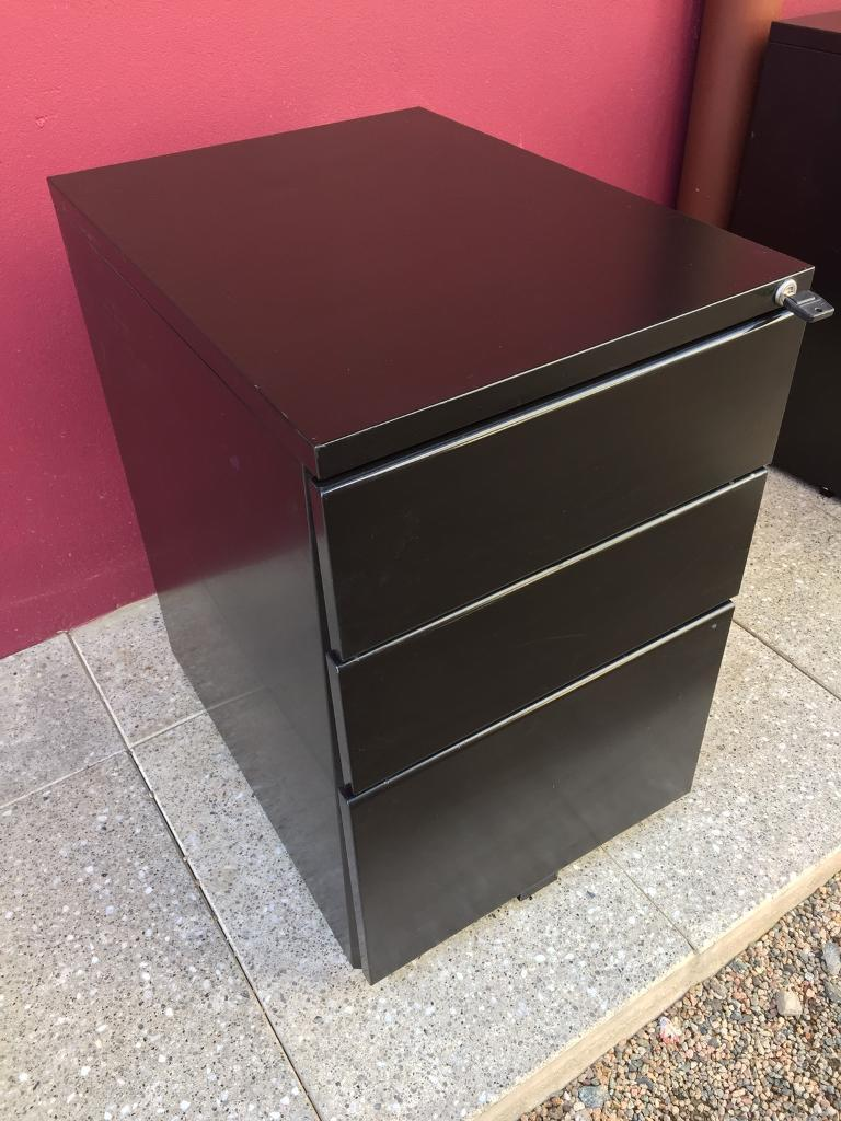 Black metal mobile filing cabinet with key