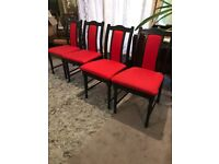4 Vintage solid wood dining chairs with red fabric seats/backs