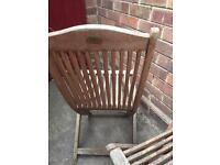 Two hardwood garden chairs