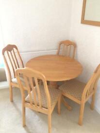 Round pine table and 4 chairs.