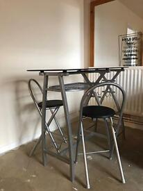 Black glass table with chairs