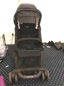 Numa pram Navy blue color Strong and sturdy.used only for 3 months with footmuff