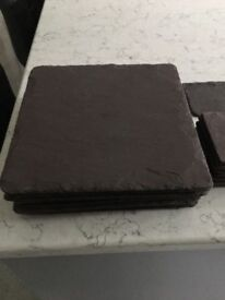 Immaculate slate place mats and matching coasters, cost £10 placemats and £5 coasters