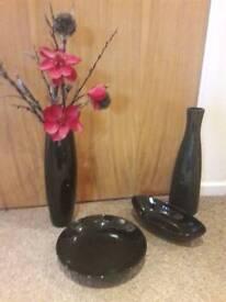 Black vases and bowls