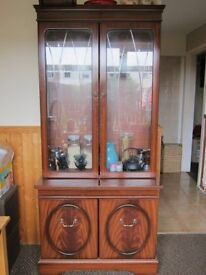 Cabinet with a glass shelf.