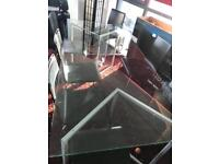 Large glass dining table with 6 leather chairs