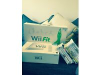 Bundle wii console, fit board and 12 games like new