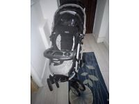 Greco baby push chair with car seat foot muff it and carry cot along with baby bag