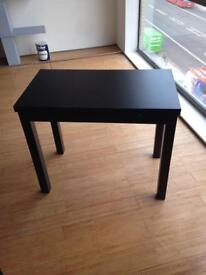 Black table with extendable leaves