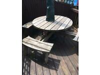 Large 8 seater solid wood garden table.