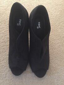 Black high heel suede shoes