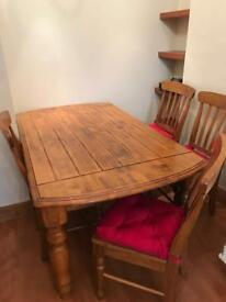 Large oak dining room table and chairs