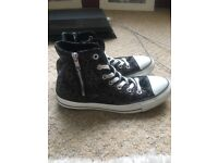 Woman's size 6 black detailed high top converse