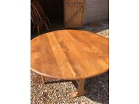 Ercol light elm dining table with 4 chairs