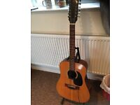 Must sell Kimbara 12 string acoustic with pick up.