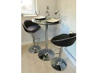 Chrome & Glass table & two bar stools