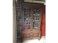 Non smoking household . Leaded glass. Cupboard underneath glass with 2 doors.