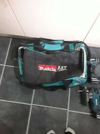 For sale 4 piece makita kit with 4 batteries, charger and bag