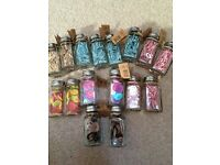 16 glass craft jars of buttons and mini pegs