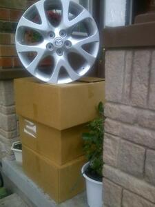BRAND NEW FACTORY MAZDA 18 INCH ALLOY RIM SET OF FOUR IN BOX.