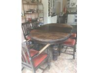 Stunning antique wood ornate dining room table with 8 chairs