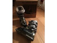 Pair of Saloman ski boots size 23.5 (approx size 8)