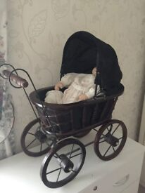 Collectors Victorian pram and china doll with soft body and pillow