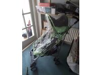 Childs fold up Buggy with rain cover.