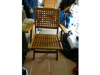 Four solid wood folding garden chairs £200 in East Ham