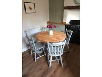 Solid pine round table and four chairs, fully refurbished