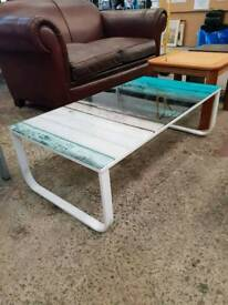 Glass coffee table with unique design