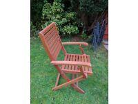 Six folding wooden garden chairs