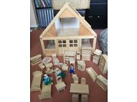 Plan wooden dolls house with loads of furniture