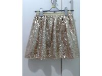 Girls gold sequinned skirt. Age 9-10 years. Excellent condition, perfect for parties.