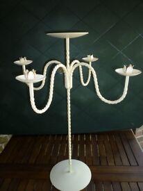 Pre-loved cream metal candelabras