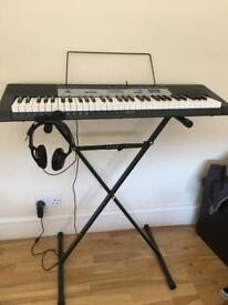 Casio electric keyboard set