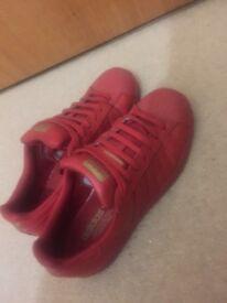 Half new adidas star shoes.